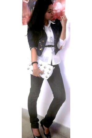 gray jacket - white shirt - black Levis jeans - white bag