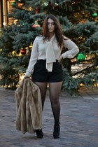 black shorts - tan coat - black clogs