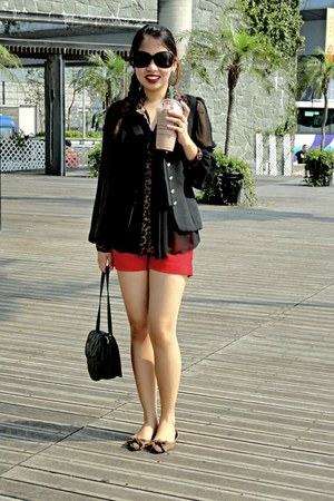 black blouse - black sling bag bag - red shorts - dark brown leopard print flats