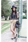 Black-thrifted-top-beige-vintage-shorts-black-country-road-shoes-black-ale