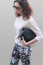 magenta printed pants Zara pants - black leather bag Nina Maya bag