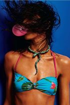 blue swimwear - green necklace