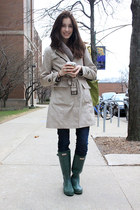 forest green rain boots Hunter boots - navy jeans - beige trench coat jacket - c