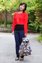 blue Aldo bag - carrot orange sweater - black top - navy pants