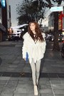 Eggshell-coat-silver-leggings-blue-bag