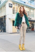 teal coat - light yellow boots - white shirt - off white pants