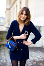 Navy-coat-white-sunglasses-blue-purse-black-tights