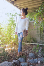 ripped jeans - asymmetrical sweater - Michael Kors wedges