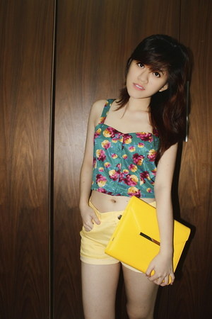 yellow wallet - light yellow shorts - turquoise blue cropped top