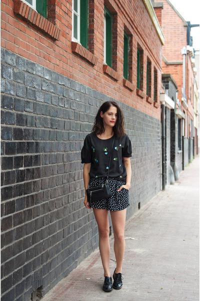 black Rebecca Minkoff bag - black polkadot Motel shorts