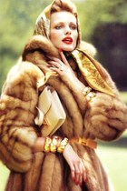 brown fur coat - eggshell Hermes bag - gold bracelet - orange Hermes belt