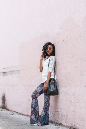 printed flares PYLO USA pants - bucket bag Furla bag - round Oxydo sunglasses