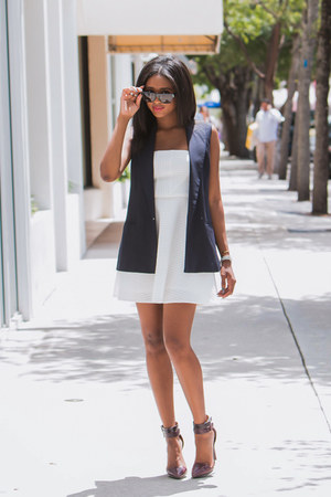 white skater Express dress - navy sleeveless Theory vest - crimson LAMB heels