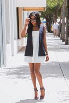 white skater Express dress - navy sleeveless Theory vest - crimson LAMB heels