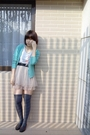 Blue-top-blue-sweater-beige-skirt-gray-socks-brown-shoes