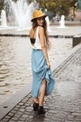 Light-orange-hat-black-bra-white-silky-top-black-wedges-light-blue-skirt