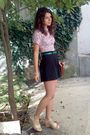 Purple-shirt-black-shorts-green-belt-brown-pigeon-purse-beige-black