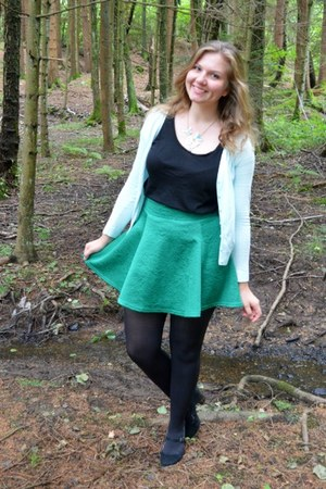 green skirt - black top - aquamarine cardigan - black pumps
