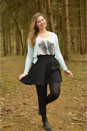 black boots - white cat top - black skirt - light blue cardigan