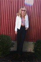 navy Levis jeans - white hollister coat - orange Buckle t-shirt