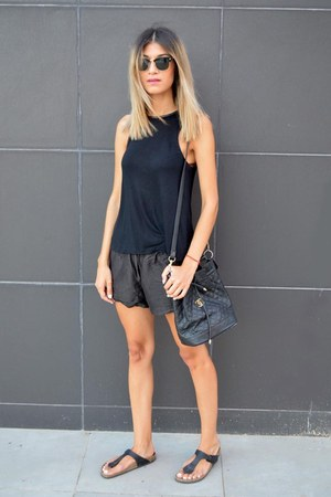 thong style Birkenstock sandals - leather Chanel bag - pyrus shorts