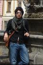 Silver-sunglasses-green-scarf-black-shirt-brown-belt-blue-jeans-brown-