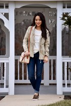 navy skinny Levis jeans - tan Dooney & Bourke bag