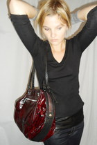 cashmere v-neck Prada sweater - maroon eel skin Gryson bag - Fluxus gloves