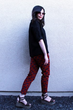 red printed pants - black textured sweater - dark brown flatform sandals