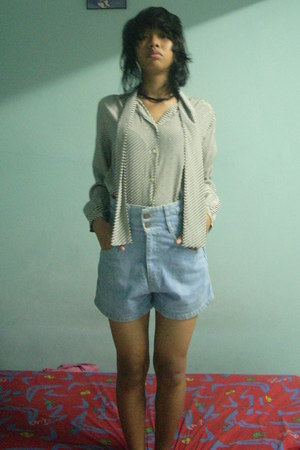 white shirt - sky blue high-waisted shorts - brown wooden necklace