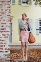 tawny purse - black blouse - light brown belt - light pink skirt - beige heels -