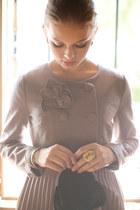 puce coat - black purse - cream ring