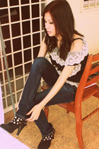 black studded boots shoes - navy jeans - black top