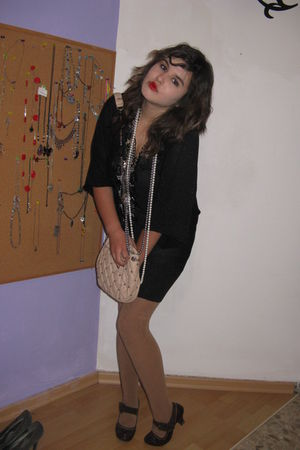 beige Zara purse - black dress