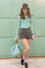 Black-oxford-shoes-black-hat-aquamarine-bag-black-heart-shorts