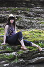 Purple-scarf-blue-top-gray-pants-yellow-hat-brown-shoes-gold-accessori