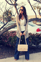 blue bishop of seventh jeans - neutral classic jumbo Chanel bag - off white silk