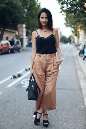 black Tous bag - crimson cropped Zara pants