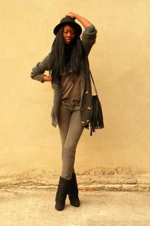 black fringed H&M bag