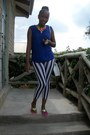 Striped-leggings-black-and-white-purse-sheer-blue-blouse-necklace