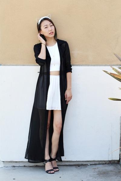 White Cardigan Black Skirt 50