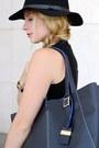 Black-h-m-hat-navy-robert-pietri-purse-charcoal-gray-mango-shorts
