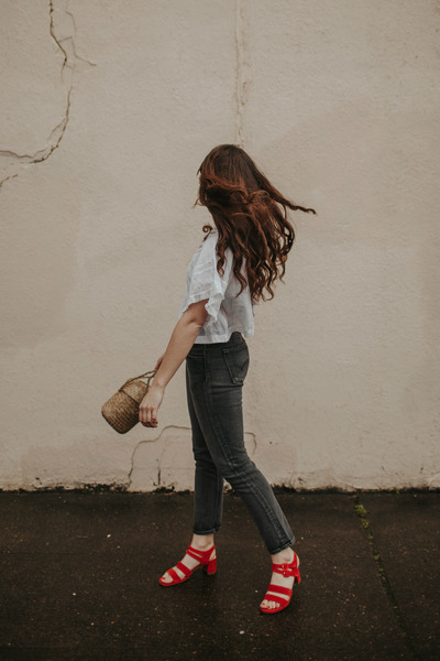 light brown purse - black Levis jeans - white free people shirt