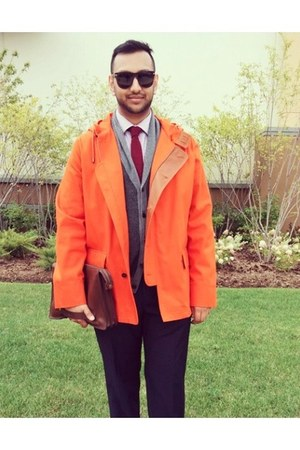 dark brown Tom Ford sunglasses - carrot orange parka Lacoste coat