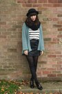 Light-blue-cardigan-black-leather-skirt