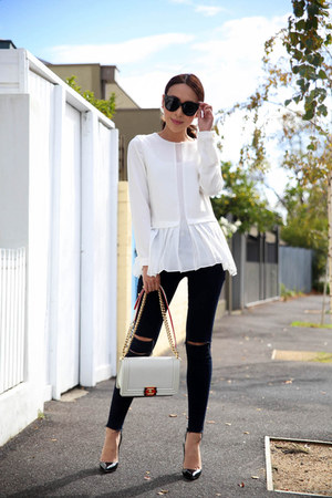 black ripped J Brand jeans - white leather Chanel bag