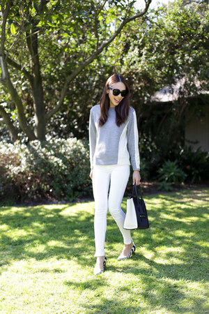 white denim Zara jeans - silver knit Saba sweater - navy luggage bag Celine bag