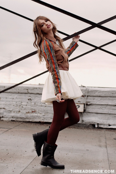 black rain boots - ivory sequin dress - camel collared jacket