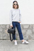 white Ray Ban sunglasses - navy Levis jeans - black Anya Hindmarch bag