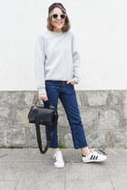 white Ray Ban sunglasses - navy Levis jeans - black Anya Hindmarch bag